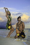 Couple dancing hula Royalty Free Stock Photos