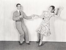Couple dancing the jitterbug Stock Photo