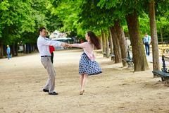 Couple dancing in the Luxembourg garden of Paris royalty free stock photos