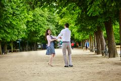 Couple dancing in the Luxembourg garden of Paris Stock Photography