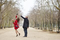 Couple dancing in the Luxembourg garden of Paris Stock Photos