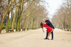 Couple dancing in the Luxembourg garden of Paris royalty free stock image