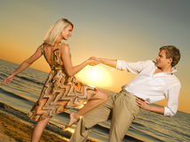Couple dancing near the ocean Stock Photography