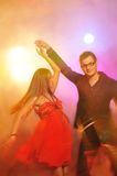 Couple dancing in the night club Royalty Free Stock Image