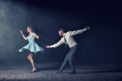 Couple dancing in the night stock image