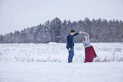Couple dancing outdoors in winter snow Royalty Free Stock Photography