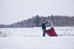 Couple dancing outdoors in winter snow Stock Photography