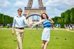 Couple dancing in Paris near the Eiffel tower Stock Photos