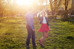 Couple dancing in the park at sunset. Loving couple dancing in the park at sunset Royalty Free Stock Photos