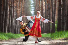 Couple dancing in russian traditional dress stock images