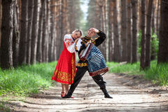 Couple dancing in russian traditional dress Royalty Free Stock Image