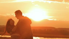 Couple dancing a slow dance in the sunset sun silhouettes, Valentine`s Day a man and a woman stock video