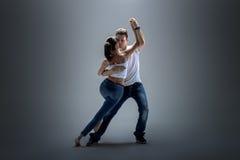 Couple dancing social danse. Beauty couple dancing social danse kizomba or bachata or semba or taraxia , on grey background stock photography