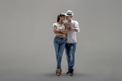 Couple dancing social danse. Beauty couple dancing social danse  kizomba or bachata or semba or taraxia , on grey background Royalty Free Stock Images