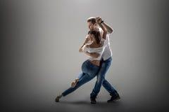 Couple dancing social danse. Beauty couple dancing social danse  kizomba or bachata or semba or taraxia , on grey background Stock Image