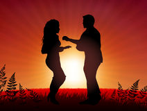 Couple dancing on sunset background Royalty Free Stock Photos