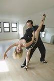 Couple dancing tango Stock Photos