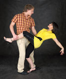 Couple dancing a tango on a black Stock Photography