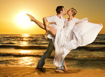 Couple Dancing Tango On The Beach Royalty Free Stock Photos
