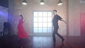 Couple dancing tango in retro room. stock video footage