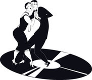Couple dancing tango on a vinyl record Stock Photos