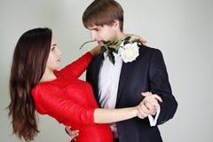 Couple dancing tango. Young beautiful couple dancing tango with a rose Royalty Free Stock Photos
