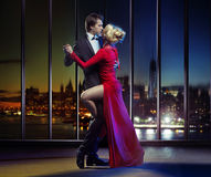 Couple dancing on the top of the skyscraper Royalty Free Stock Photography