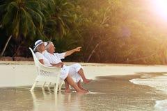 Couple  dancing  on  tropical beach. Happy elderly  couple  dancing  on  tropical beach Stock Photo
