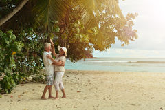 Couple  dancing  on  tropical beach. Happy elderly  couple  dancing  on  tropical beach Royalty Free Stock Images