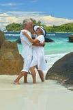 Couple  dancing  on  tropical beach. Happy elderly  couple  dancing  on  tropical beach Royalty Free Stock Image