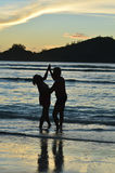 couple  dancing  on  tropical beach Stock Images