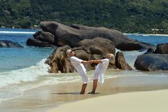 Couple  dancing  on  tropical beach. Happy elderly  couple  dancing  on  tropical beach Stock Image