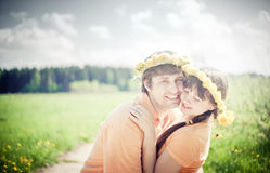 Couple in dandelion wreath Royalty Free Stock Photos