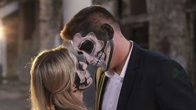 Couple with skull makeup on the background of an abandoned building. Halloween. Couple with dark skull makeup against the background of an abandoned building stock video footage