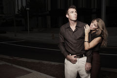 Couple in a dark urban setting Royalty Free Stock Images