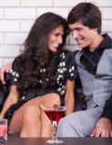 Couple on date in bar or night club Stock Images