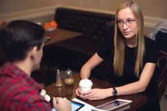 Couple is on date in cafe drinking coffee, girl Stock Photos