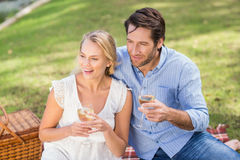 Couple on date holding a glass of white wine Royalty Free Stock Photography
