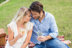 Couple on date holding white wine glasses. Cute couple on date holding white wine glasses Stock Photography
