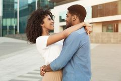 Couple date. Romantic african-american pair walking in city. Couple date. Romantic african-american pair hugging and walking in city royalty free stock photography