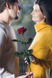 Couple at date with rose Royalty Free Stock Image