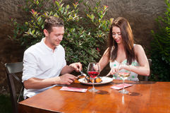 Couple on date tasting desert and wine on terrace Stock Images