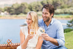 Couple on date toasting with glass of white wine Stock Images