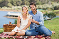 Couple on date toasting with glass of white wine Royalty Free Stock Images