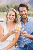 Couple on date toasting with glass of white wine Stock Photos