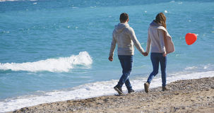 Couple on a date walking near the sea Stock Photo
