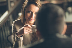 Couple dating at the bar. Young fashionable couple dating at the bar, she is having a coffee Stock Photo