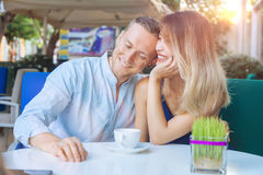 Couple dating drinking coffee. Attractive men and women smiling Stock Image
