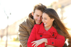 Couple dating and hugging in love in a park. Couple dating and hugging in love in an urban park in a sunny day Royalty Free Stock Photo