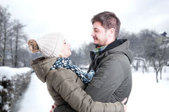 Couple dating and hugging in winter park. And looking adorable royalty free stock photography